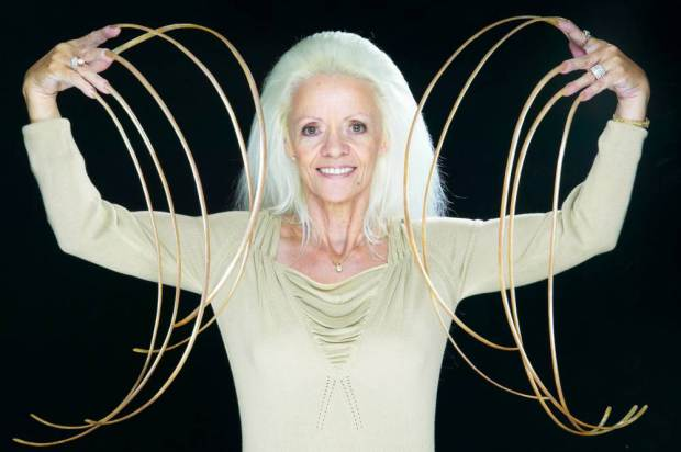Undated handout photo issued by Guinness World Records of Lee Redmond, who had the longest fingernails ever with a length of 8.65m (28ft 4.5in) in 2008, as the Guinness World Records celebrates its 60th anniversary. PRESS ASSOCIATION Photo. Issue date: Thursday August 27, 2015. 60 years on, over 134 million copies have been sold in 21 languages, in more than 100 countries. See PA story SOCIAL Guinness. Photo credit should read: Drew Gardner/Guinness World Records/PA Wire NOTE TO EDITORS: This handout photo may only be used in for editorial reporting purposes for the contemporaneous illustration of events, things or the people in the image or facts mentioned in the caption. Reuse of the picture may require further permission from the copyright holder.
