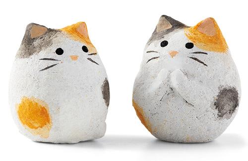 katzenfiguren in glückskeksen